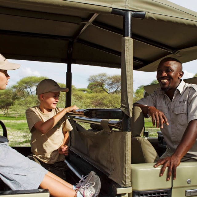 kids on a safari game drive