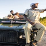 guide pointing out animals during a safari game drive