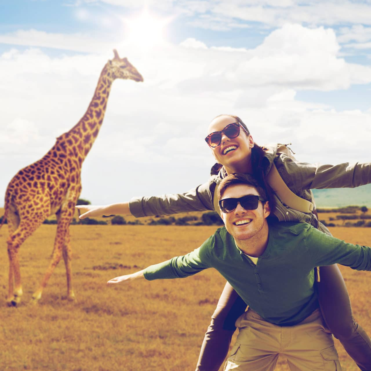 people on a safari and giraffe